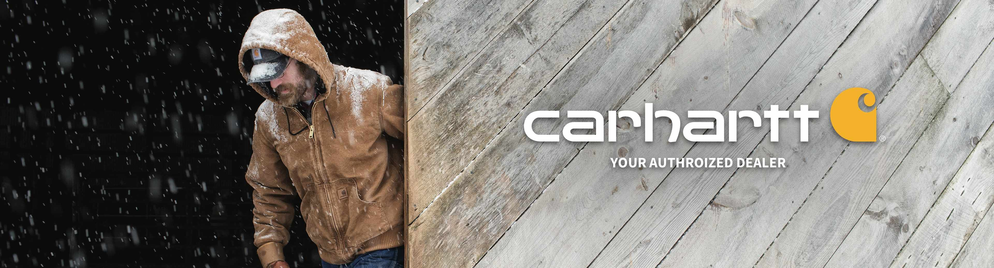 Carhartt logo with person wearing Carhartt jacket with words Your Authorized Dealer